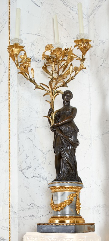 Candelabra in the form of woman holding bouquets of lilies and hyacinths