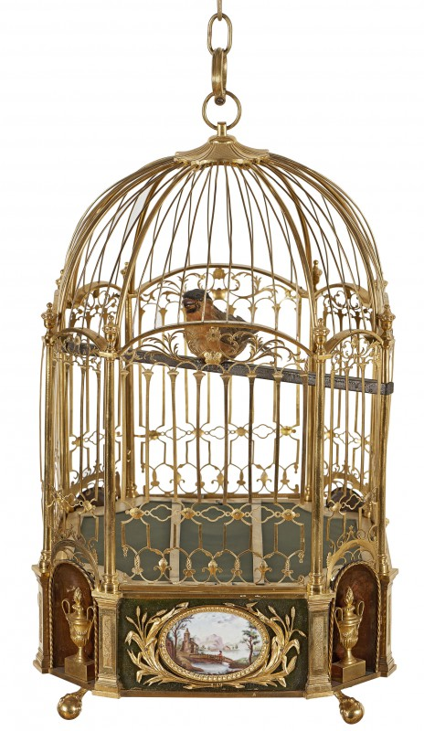 Musical clock in the form of a cage with bird