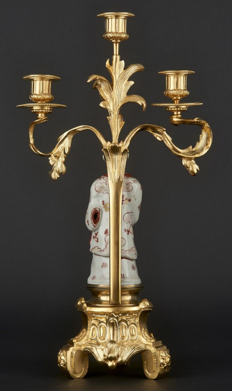Three-branch candelabra with porcelain figurine of Japanese man