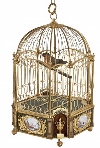 Musical clock in the form of a cage with bird - 1